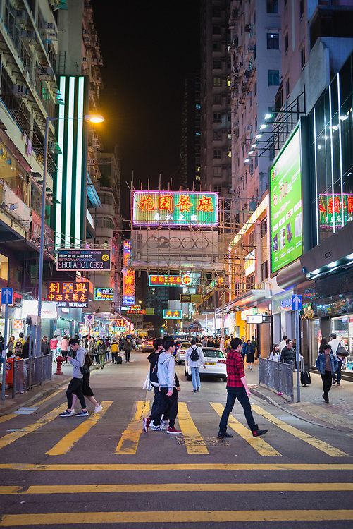 People on streets of Kowloon late at night