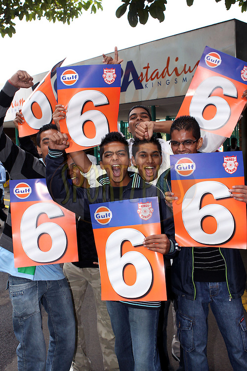 DURBAN, SOUTH AFRICA - 21 April 2009. Fans celebrate during the IPL Season 2 match between the Kings X1 Punjab and the Kolkata Knight Riders held at Sahara Stadium Kingsmead, Durban, South Africa..