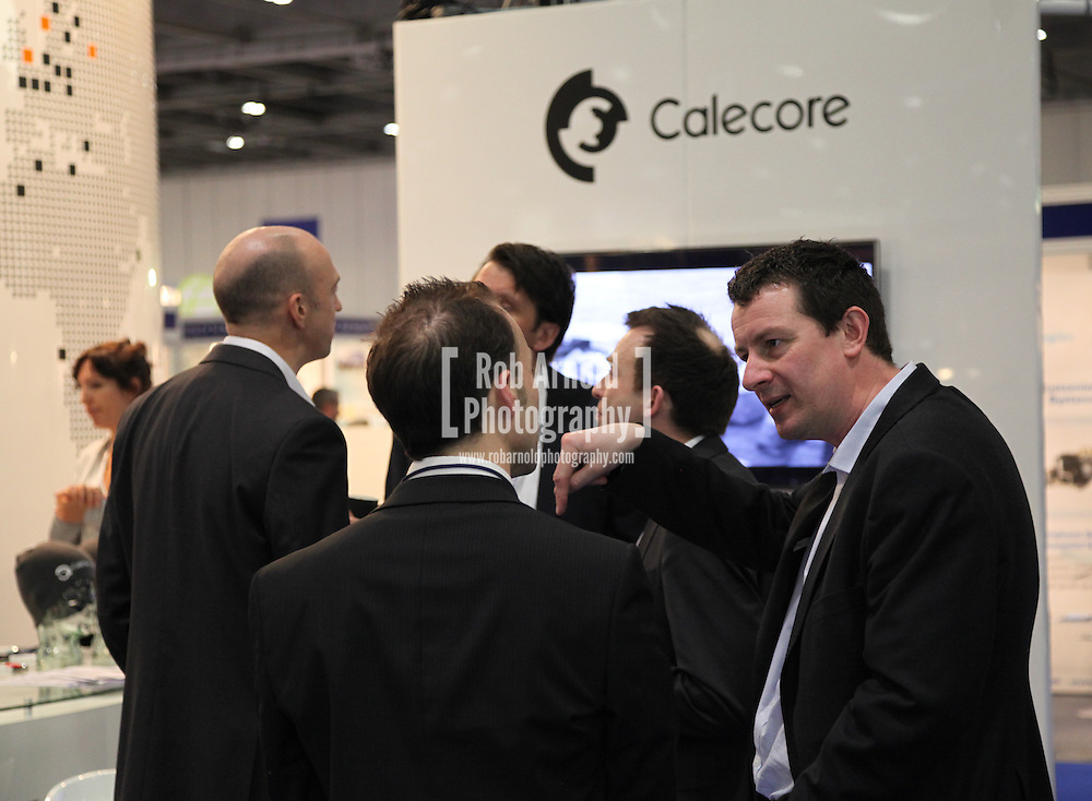 © Rob Arnold 11/03/2014. London, UK. Calecore Director, Steve Lloyd at The Calecore stand at Oceanology International (OI), the world's largest exhibition for marine science and technology held at London's ExCeL Centre. The three day exhibition provides an opportunity for industry, academic and government organisations to share knowledge and promote improvements in technology and strategy used for operating, surveying, protecting and exploiting resources in the oceans of the world. Photo Credit : Rob Arnold