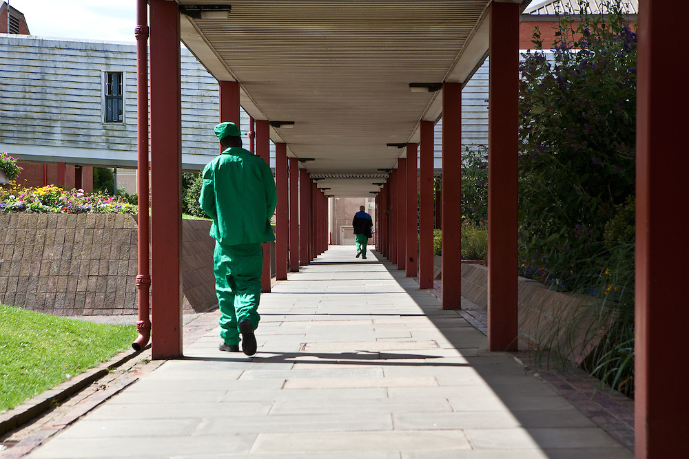 Prisoners walking through the grounds of the prison. HMP The Mount, Bovingdon, Hertfordshire