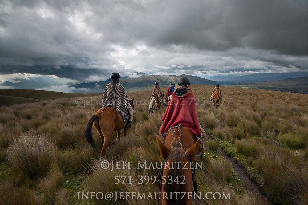 Horseback riding in Ecuador's high altitude grasslands known as the Paramo.