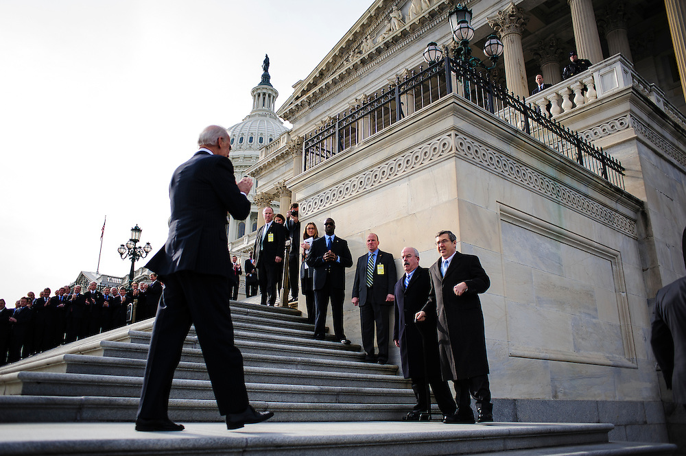 Vice President Joe Biden greets Senate Sargent at Arms Terrance Gainer as he escorts Senator Mark Kirk (R-IL) as he makes his return to Congress at the U.S. Capitol in Washington, District of Columbia, U.S., on Thursday, Jan. 3, 2013. Kirk, 53, climbed the steps at 10:30 a.m. accompanied by Vice President Joe Biden and Senator Dick Durbin (D-IL). The 133th Congress begins Thursday with the swearing in of newly elected Members of Congress and the election of the Speaker of the House of Representatives. Photographer: Pete Marovich/Bloomberg