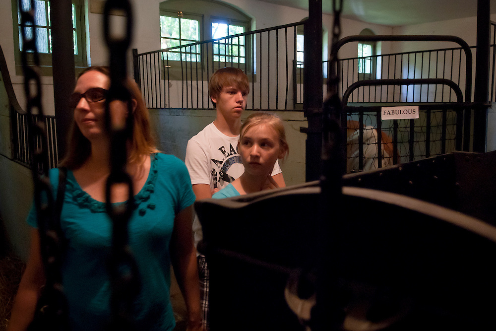 Lathan Goumas | MLive.com..Members of the Slater family from Swartz Creek, tour the horse barn during a Summer Fun Day event at the Applewood Estate in Flint, Mich. on Thursday June 14, 2012.