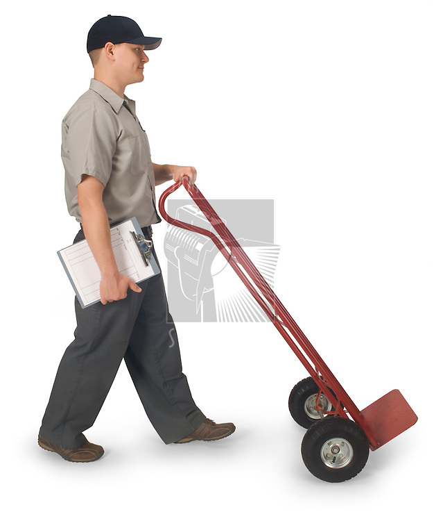 Delivery man walking with an empty hand truck, isolated on a white background with clipping path