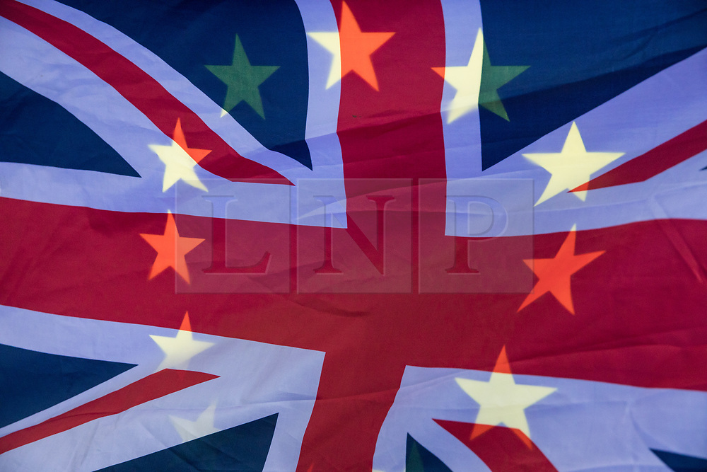 © Licensed to London News Pictures. 14/11/2017. London, UK. The EU flag showing through the Union Jack as anti-Brexit protesters demonstrate outside Parliament as MPs debate the European Union (Withdrawal) Bill. Photo credit: Rob Pinney/LNP