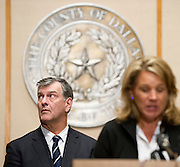 Dallas Mayor Mike Rawlings looks on while Councilmember Jennifer Staubach Gates speaks during a press conference updating the community about the Ebola patient Thomas E. Duncan in Dallas, Texas on October 6, 2014. (Cooper Neill for The Texas Tribune)