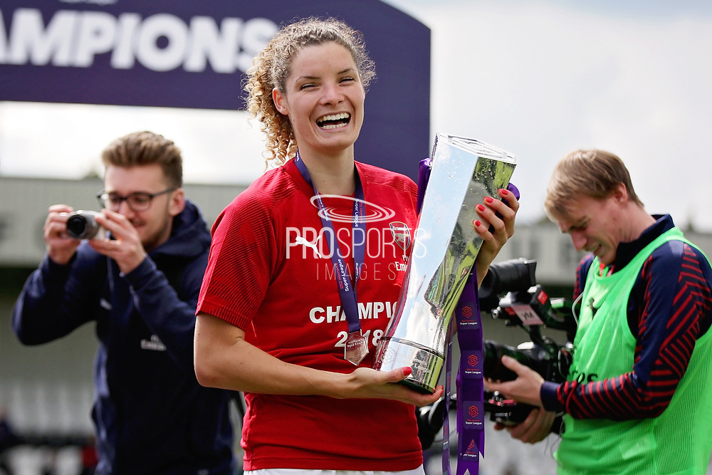 Arsenal midfielder Dominique Bloodworth (20) with the  Women's Super League Trophy after  the FA Women's Super League match between Arsenal Women FC and Manchester City Women at Meadow Park, Borehamwood, United Kingdom on 12 May 2019.