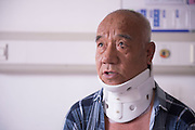 CHANGCHUN, CHINA - JUNE 23: (CHINA OUT)<br /> <br /> Man Recovered With 3D Printed Cervical Vertebra <br /> <br />  Fu Zuohua is seen after the surgery at the Second Hospital of Jilin University on June 23, 2015 in Changchun, Jilin Province of China. 66-year-old Fu Zuohua, who has cervical vertebra hyperosteogeny, received a surgery with a 3D printed cervical vertebra implant made of titanium on June 19, and he recoverd to a better condition.<br /> ©Exclusivepix Media