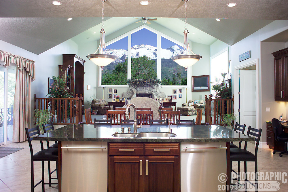 Upscale kitchen designed around the view of the nearby mountain peaks