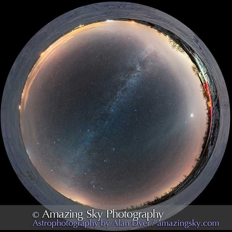 A 360&deg; fish-eye scene of the winter sky from home in southern Alberta, with Orion rising into the southeast at bottom, and Venus bright as an evening &ldquo;star&rdquo; in the west at right. The Big Dipper is low in the northeast at upper left. The Milky Way runs across the sky from northwest where summer stars are setting to the southeast where the winter stars are rising. Sirius is just rising behind the distant trees at lower left. Overhead are the autumn constellations of Cassiopeia. Andromeda, and Perseus. Below centre is the Pleiades and stars of Taurus. Some faint Zodiacal light is visible at right in the southwest, near Venus but competes with the haze and lights from towns to the west. <br /> <br /> This is a stitch of 6 segments taken with the Rokinon 12mm full-frame fish-eye lens, landscape orientation, and Nikon D750, in a test of the lens&rsquo;s ability to shoot horizon to zenith pans in this mode. At f/2.8 and ISO 3200 for 25 seconds each, untracked. Stitched with PTGui. The original is 8300 pixels wide.