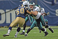 Philadelphia Eagles full back Josh Parry (R) blocks out St. Louis Rams linebacker Pisa Tinoisamoa (L) during the fourth quarter, at the Edward Jones Dome in St. Louis, Missouri, December 18, 2005.  The Eagles beat the Rams 17-16.