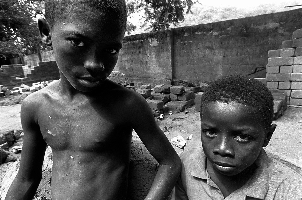 Lakka, Sierra Leone. April 1999..War veterans of the civil war in Sierra Leone, Mohamed K'mala (10) and Saido Kargbo (12), a former corporal in the Small Boys Army. Both boys were abducted from their homes by the RUF and were moulded into trained killers and then drugged with cocaine. They were released in March 1999 and are now being rehabilitated in St Michaels, just outside Freetown.