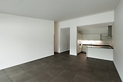 interior of new apartment, empty room with domestic kitchen