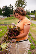 Young woman in Dancing Roots Farm in Troutdale, Oregon.