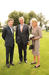 Left to right, JOHN WARREN the Queen's racing manager and LUCA & SARA CUMANI at the third day of the 2010 Glorious Goodwood racing festival at Goodwood Racecourse, Chichester, West Sussex on 29th July 2010.