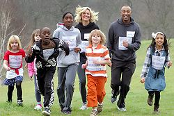 ©London News pictures. 17.02.2011. Olympic medallist Colin Jackson and TV presenter Nell McAndrew join Greenwich school children in Greenwich Park to encourage 1 million children to sign-up to this year's Tesco Great School Run.  Picture Credit should read Carmen Valino/LNP