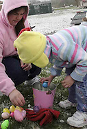 After the Easter egg hunt, Lisa Sullivan (left) and daughter Kaitlyn, 5, from El Paso Texas check out what's inside their eggs..