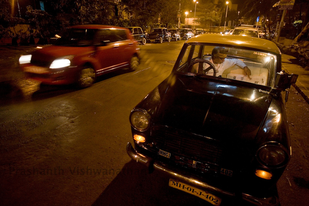 A taxi driver awaits customers at night in the Colaba area of Mumbai, India, February 8, 2008. Prashanth Vishwanathan\ATLAS PRESS
