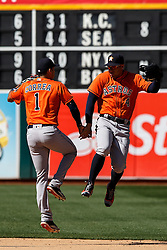 OAKLAND, CA - MAY 01: Carlos Correa #1 of the Houston Astros celebrates with George Springer #4 after the game against the Oakland Athletics at the Oakland Coliseum on May 1, 2016 in Oakland, California. The Houston Astros defeated the Oakland Athletics 2-1. (Photo by Jason O. Watson/Getty Images) *** Local Caption *** Carlos Correa; George Springer