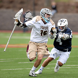 Staff photos by Tom Kelly IV<br /> Haverford's John Nostrant (16) runs with the ball as Episcopal's Benjamin Valdes (4) tries to check him, during the Episcopal Academy at the Haverford School boys lacrosse game on Tuesday, April 7, 2015.