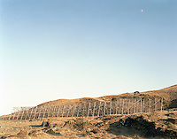 Blå himmel og måne over et tørrfiskhjell på Vigra.<br /> Foto: Svein Ove Ekornesvåg