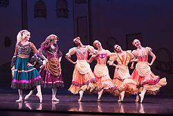 © Licensed to London News Pictures. 18/09/2015. London, UK. Les Ballets Trockadero de Monte Carlo (The Trocks) perform the UK premiere of Don Quixote during a photocall at the Peacock Theatre. With Yakaterian Verbosovich (Chase Johnsey) as Kitri, PVyacheslav Legupski (Paolo Cervellera) as Basil, Olga Supphozova (Robert Carter) as Amour, Lariska Dumbcheno (Raffaele Morra) as Mother, Boris Nowitsky (Carlos Renedo) as Count and Varvara Bractchikova (Giovanni Goffredo) and Eugenia Repelskii (Joshua Thake) as Gypsies. Photo credit: Bettina Strenske/LNP