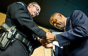 Irvine Police Chief Mike Hamel bows his head in prayer with Pastor Mark Whitlock of Christ Our Redeemer AME Church after tying a thread around each other's wrists as a symbol of unity during a  &quot;thread ceremony&quot; at Christ Our Redeemer AME Church in Irvine.<br /> <br /> ///ADDITIONAL INFORMATION: David.PolicePeace.0716 &ndash; 7/14/16 &ndash; NICK AGRO, ORANGE COUNTY REGISTER-   <br /> Irvine Pastors and leaders will voice their love for the city, law enforcement and neighbors on July 14 at 4PM. They will perform a special &ldquo;thread ceremony&rdquo; where they will tie city officials, police officers, and people of different ethnicity, beliefs, sexual orientations and cultures with a thread that symbolizes solidarity, unity and being tied together as a community.