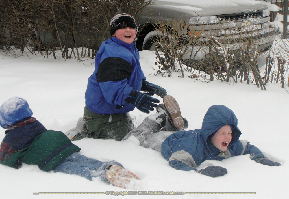 (left to right) Destiny Richardson, 6, Chance Textor, 10 and Keigen Richardson, 8, all of Dayton play in the snow during Tuesday's Winter storm.