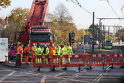 Workers at the site of the Croydon tram crash stand during a two minute silence to mark Armistice Day.
