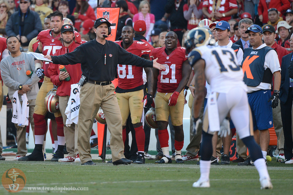 December 1, 2013; San Francisco, CA, USA; San Francisco 49ers head coach Jim Harbaugh reacts after a fumble by running back Frank Gore (21) against the St. Louis Rams during the third quarter at Candlestick Park. The 49ers defeated the Rams 23-13.