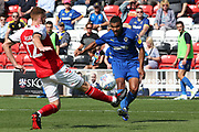 AFC Wimbledon striker Kwesi Appiah (9) gets the shot away despite the attention of Fleetwood Town defender Cian Bolger (12) during the EFL Sky Bet League 1 match between Fleetwood Town and AFC Wimbledon at the Highbury Stadium, Fleetwood, England on 4 August 2018. Picture by Craig Galloway.