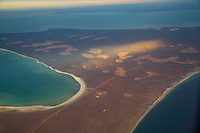 Shark Bay and Monkey Mia from the air and the Birriea's Gyesum (meaning thirsty in aboriginal languge) they are the large markings in the landscape, the saltpans. Monkey Mia Shark Bay is 850 kms north of Western Australian capital Perth. Situated mid way up the Western Australian coast the area famous for it's wild dolphins and is classified as a World Heritage Region.