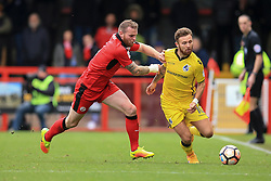 Matt Taylor of Bristol Rovers is tackled by Mark Connolly of Crawley Town - Mandatory by-line: Jason Brown/JMP - 05/11/2016 - FOOTBALL - Checkatrade.com Stadium - Crawley, England - Crawley Town v Bristol Rovers - Emirates FA Cup first round