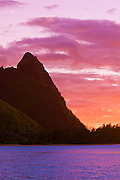 Evening light on spires of the Na Pali Coast at sunset, North Shore, Island of Kauai, Hawaii