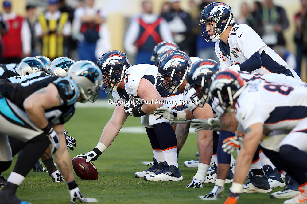 Denver Broncos quarterback Peyton Manning (18) stands over center as Denver Broncos center Matt Paradis (61) gets set to snap the ball at the line of scrimmage as the Broncos offensive line defends against the Carolina Panthers defensive line during the NFL Super Bowl 50 football game against the Carolina Panthers on Sunday, Feb. 7, 2016 in Santa Clara, Calif. The Broncos won the game 24-10. (©Paul Anthony Spinelli)