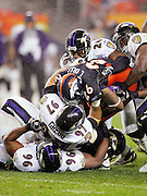 DENVER - OCTOBER 9:  Running back Tatum Bell #26 of the Denver Broncos gets gang tackled by Dawan Landry #26, Kelly Gregg #97, and Adalium Thomas #96 of the Baltimore Ravens at INVESCO Field at Mile High on October 9, 2006 in Denver, Colorado. The Broncos defeated the Ravens 13-3. ©Paul Anthony Spinelli *** Local Caption *** Tatum Bell;Dawan Landry;Kelly Gregg;Adalium Thomas