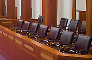 An empty jury box in a modern courtroom.