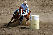 061811-Evergreen, COLORADO-evergreenrodeo-Sami Jo Sweeney, of Brighton, CO, turns the final barrel during the Evergreen Rodeo Saturday, June 18, 2011 at the El Pinal Rodeo Grounds..Photo By Matthew Jonas/Evergreen Newspapers/Photo Editor