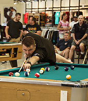 Top US professional pool player Mike Dechaine takes a shot during scotch doubles with his partner Buddy Oldham during the Harley Davidson's Pool Tournament with Tavern Player's on Sunday afternoon to benefit the Childrens Auction.  (Karen Bobotas/for the Laconia Daily Sun)