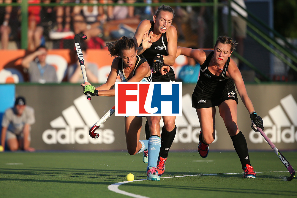 ROSARIO, ARGENTINA - DECEMBER 13:  Delfina Merino of Argentina competes with Kirsten Pearce and Liz Thompson of New Zealand during the final match between Argentina and New Zealand on day 9 of the Hockey World League Final on December 13, 2015 in Rosario, Argentina.  (Photo by Chris Brunskill/Getty Images)