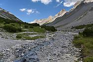 Pine trees, the creek Ova da Stugl and peaks in the valley Val da Stugl, Parc Ela, Grisons, Switzerland