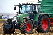 A modern European farm tractor in a German cornfield outside Wurzburg.