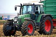 A modern European farm tractor in a German cornfield outside Wurzburg.