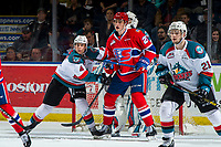 KELOWNA, CANADA - MARCH 13:  Devin Steffler #4 and Schael Higson #21 of the Kelowna Rockets defend the net and check Jack Finley #26 of the Spokane Chiefs during first period on March 13, 2019 at Prospera Place in Kelowna, British Columbia, Canada.  (Photo by Marissa Baecker/Shoot the Breeze)