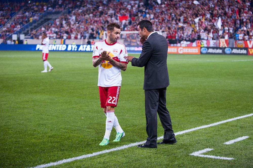 HARRISON, NJ - AUGUST 17:  Head Coach Mike Petke of the New York Red Bulls chats with Jonny Steele #22 during the game against the Philadelphia Union at Red Bulls Arena on August 17, 2013. (Photo By: Rob Tringali)