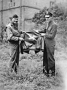 James Neal Workman holds up his A-2 jacket, probably in England.  He was a B-24 pilot, and participated in the D-Day invasion.