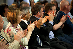 © Licensed to London News Pictures. 22/06/2013. Birmingham, UK. Ed Miliband MP, Leader of the Labour Party, giving a key note speech to Labour's National Policy Forum (NPF) in Birmingham is applauded at the end of his speech by Harriett Harman and Ed Balls. Photo credit : Dave Warren/LNP