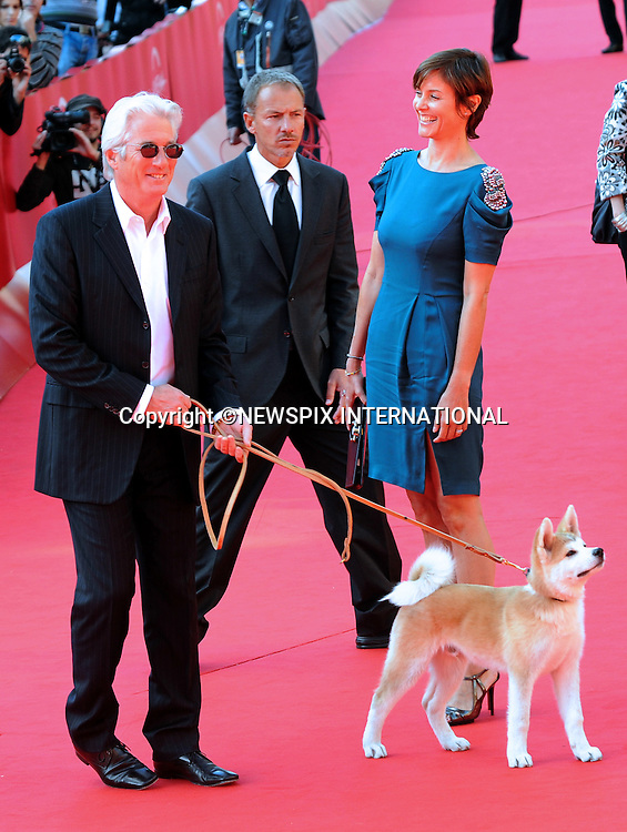 "RICHARD GERE AND CAREY LOWELL.at the screening of ""Hachiko,"" starring a Japanese Akita dog, 4th International Rome Film Festival,  Auditorium Parco della Musica, Rome_17/10/2009.Mandatory Credit Photo: ©NEWSPIX INTERNATIONAL..**ALL FEES PAYABLE TO: ""NEWSPIX INTERNATIONAL""**..IMMEDIATE CONFIRMATION OF USAGE REQUIRED:.Newspix International, 31 Chinnery Hill, Bishop's Stortford, ENGLAND CM23 3PS.Tel:+441279 324672  ; Fax: +441279656877.Mobile:  07775681153.e-mail: info@newspixinternational.co.uk"