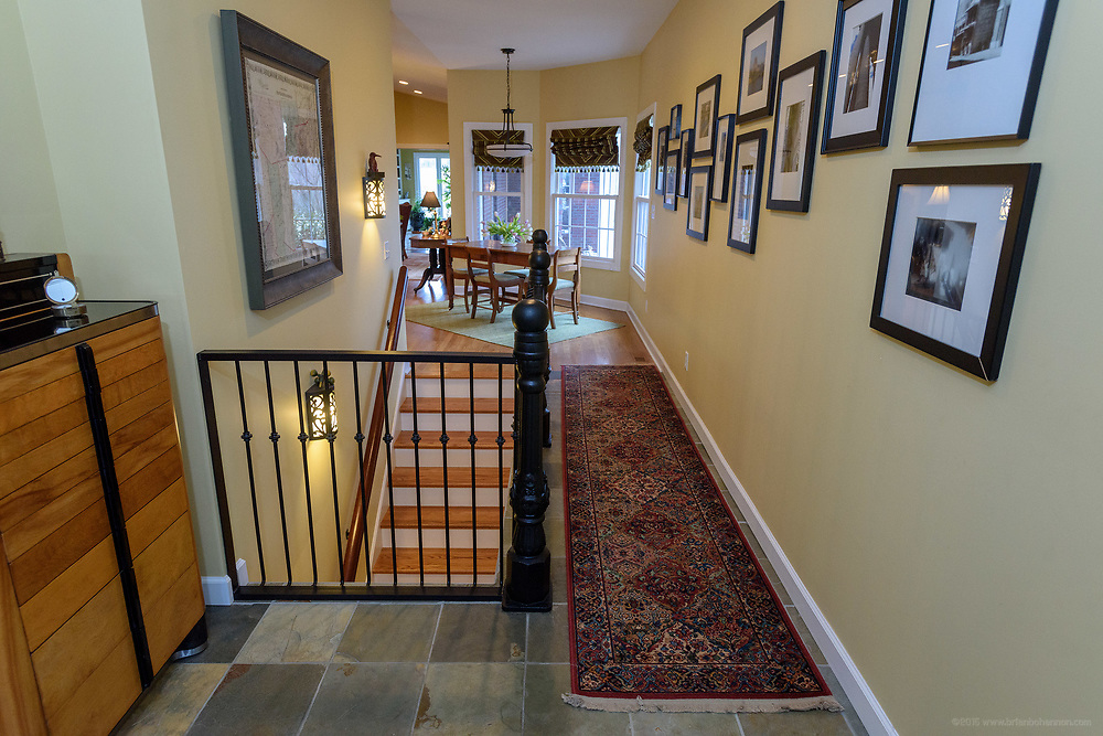 Photos by Kristen of New Orleans and Paris hang in the hallway from the side entrance foyer to the living area at the home of Kristen and David Embry in Pendleton, Ky. Feb. 22, 2018