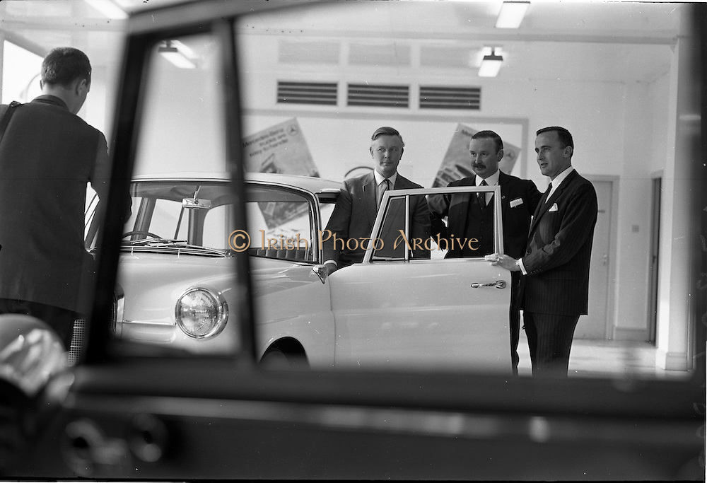 03/06/1964<br /> 06/03/1964<br /> 03 June 1964<br /> Mercedes introduce new cars to the Irish Market at a reception held at Ballsbridge Motors Ltd., Dublin. The cars were the Mercedes benz Type 220SE de Luxe and Type 190C Automotive. Picture shows (l-r): Mr. T. Andrews, General manager  Ballsbridge Motors Ltd.; Mr. P.J. Moylett, General Sales Manager, Ballsbridge Motors Ltd. and Mr. M. O'Flaherty, Director Ballsbridge Motors Ltd. with one of the new cars in the showroom.